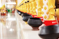 Alms on table. In temple of Thailand stock image