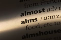 Alms. Word in a dictionary.  concept royalty free stock photo