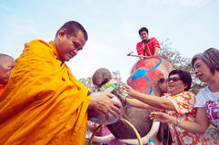 Almsgiving in Thailand Royalty Free Stock Photography