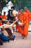 Almsgiving to put sticky rice at Luang Prabang Cit Stock Photo