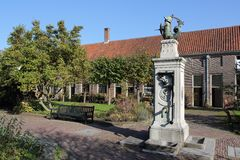 Almshouse Leiden with water pump Royalty Free Stock Images