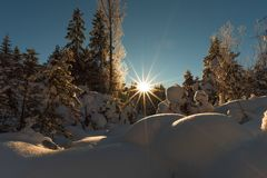 The Almtal in Upper Austria covered in deep snow an enlightened by the rising sun. The Almtal in the Upper Austrian Alps is one of the most beautiful places to Royalty Free Stock Photography