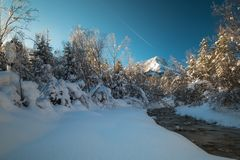 The Almtal in Upper Austria covered in deep snow with sunshine. The Almtal in the Upper Austrian Alps is one of the most beautiful places to be in winter. Deep Royalty Free Stock Image