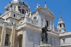 Almudena Cathedral in Madrid. Almudena Cathedral (Cathedral of Saint Mary the Royal of La Almudena) and Pope John Paul II statue in Madrid, Spain Stock Image