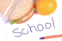 Almuerzo de escuela escrito en creyón Fotografía de archivo libre de regalías