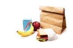 Almuerzo de escuela sano con el bolso marrón Fotos de archivo