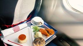 Almuerzo en la clase de negocios a bordo de los aviones Imagenes de archivo