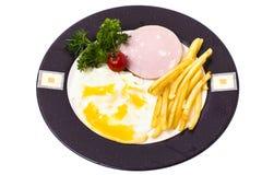 Almuerzo o desayuno caluroso delicioso en la placa Imagen de archivo libre de regalías