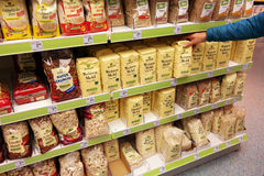 Alnatura organic food. GERMANY - JULY 2015: Aisle with Alnatura products in a Dm-drogerie markt store. Alnatura producer and trader of organic food and operates royalty free stock image
