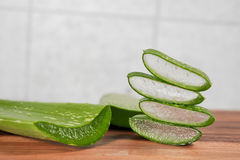 Aloe thin slice. On wood table Royalty Free Stock Photography