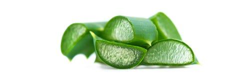 Aloe Vera closeup on white background. Sliced Aloevera. Natural organic renewal cosmetics, alternative medicine. Skincare. Concept stock images