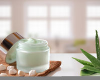 Aloe Vera Cream jar open on burlap windows background Stock Photography