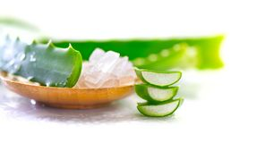 Aloe Vera gel closeup. Sliced Aloevera natural organic renewal cosmetics, alternative medicine. Organic skincare concept. On white wooden background stock images