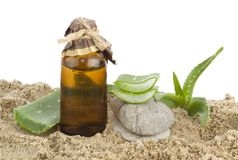 Aloe vera and dropper. Aloe vera leafs and dropper on sands stock images