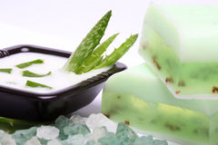 Aloe vera leaves, bath salt, handmade soap Royalty Free Stock Photos