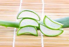 Aloe vera sliced on Japanese mat. Herb Royalty Free Stock Image