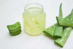 Aloe vera transparent essence with fresh leaves. stock images