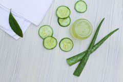 Aloe vera transparent extract with fresh leaves and sliced salad. royalty free stock images