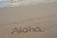 Aloha. Sand writing in Hawaiian on beach Royalty Free Stock Images