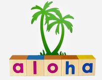 Aloha. Concept spelled with toy blocks with ornamental green palm tree. Isolated Royalty Free Stock Image
