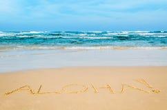 Aloha. Inscription on the beach Royalty Free Stock Photography