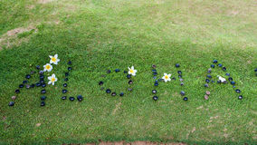 ALOHA from Maui. A message of aloha with flowers and rocks on green grass Royalty Free Stock Image