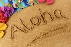 Aloha scrittura della spiaggia Immagini Stock