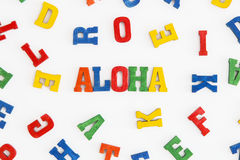 Aloha. Series Hello: word Aloha (hello in Hawaiian) in wooden letters on white background Royalty Free Stock Image