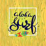 Aloha surf letterin hand drawn with surf board. Aloha surf lettering. Vector calligraphy illustration. handmade graphics Stock Image