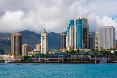 Aloha Tower. View of Aloha Tower and Aloha Market place on the harbor Stock Images