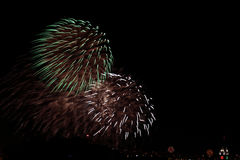Aloha Tower Fireworks. As seen in the background, the Aloha Tower fireworks competed with aerial fireworks from folks who stayed home Royalty Free Stock Photo