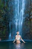 Aloha waterfall lei woman. Beautiful exotic woman in front of waterfall Royalty Free Stock Photos