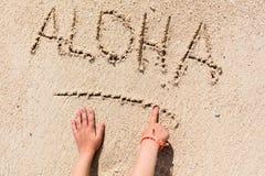 ALOHA beach vacation. ALOHA word written on tropical sand beach Royalty Free Stock Photo