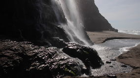 Alomere Waterfall in Northern California. The Alomere waterfall flows from a cliff to the beach at Point Reyes National Seashore in northern California. This stock footage