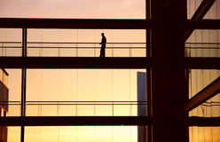 Alone. Worker alone in the modern building in sepia tone Royalty Free Stock Photography