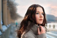 Alone. Young woman stands alone on the street Royalty Free Stock Photography