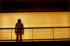 Alone. A woman in a building (toned yellow Stock Photography