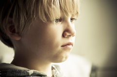 Alone. A sad little boy who is lonely Stock Image