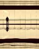 Alone. Worker alone in the modern building in sepia tone Royalty Free Stock Image