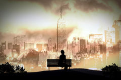 Alone. A person sitting alone on a bench in New York Stock Photos