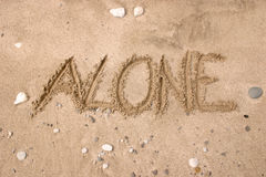 Alone. Drawing on the sand - Alone stock photos