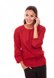 Alone adult brunette speaking on her phone Stock Photography
