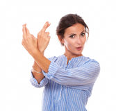 Alone adult lady with wishing fingers Royalty Free Stock Photography