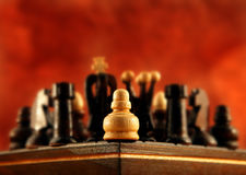 Alone against everybody. A little pawn is alone in the corner against everybody Stock Image