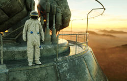 Alone astronaut on alien planet. Martian on metal base. Future concept. 3d rendering. Royalty Free Stock Photography