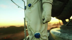 Alone astronaut on alien planet. Martian on metal base. Future concept. 4k
