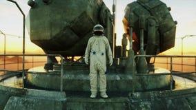 Alone astronaut on alien planet. Martian on metal base. Future concept. 4k stock video