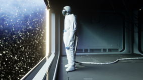 Alone astronaut in futuristic space corridor, room. view of the earth. cinematic 4k footage.