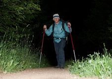 Alone backpacker hikes at night Royalty Free Stock Photo