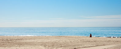 Alone on the beach Royalty Free Stock Photography